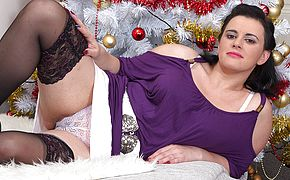 Naughty housewife jerking under the christmas tree