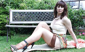 Horny British housewife flashes her molten assets and strokes in the garden