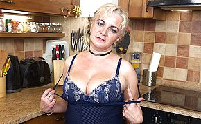 Kinky housewife frolicking in the kitchen