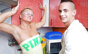 Kinky housewife penetrating in her kitchen