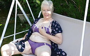 Kinky grandmother frolicking in the garden with her fuckbox