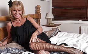 Fashionable mature damsel getting all naughty