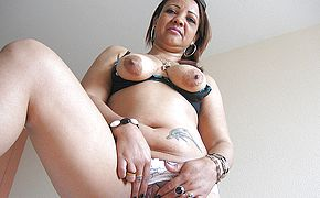 Horny mature Patricia enjoys frolicking with her fucktoys