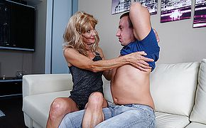 Insatiable mature housewife humps her toyboy