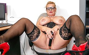 German Milf secretary shows great rack and masturbates