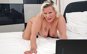 Horny housewife works her wet pussy