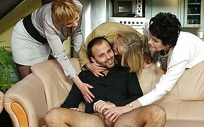 Three mature ladies catch a guy jerking off